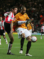 Photo: Lee Earle/Sportsbeat Images.<br /> Southampton v Hull City. Coca Cola Championship. 08/12/2007. Hull's Caleb Folan (R) holds off Alan Bennett.