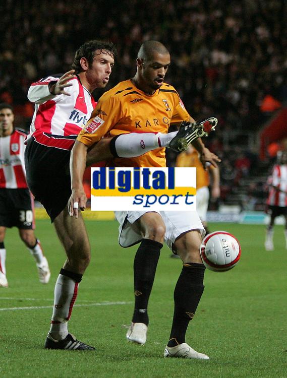 Photo: Lee Earle/Sportsbeat Images.<br /> Southampton v Hull City. Coca Cola Championship. 08/12/2007. Hull's Caleb Folan (R) holds off Alan Bennett.