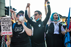 London, UK. 20 September, 2019. Students and climate campaigners celebrate having blocked Lambeth Bridge during the second Global Climate Strike in protest against a lack of urgent action by the UK Government to combat the global climate crisis. The Global Climate Strike grew out of the Fridays for Future movement and is organised in the UK by the UK Student Climate Network.