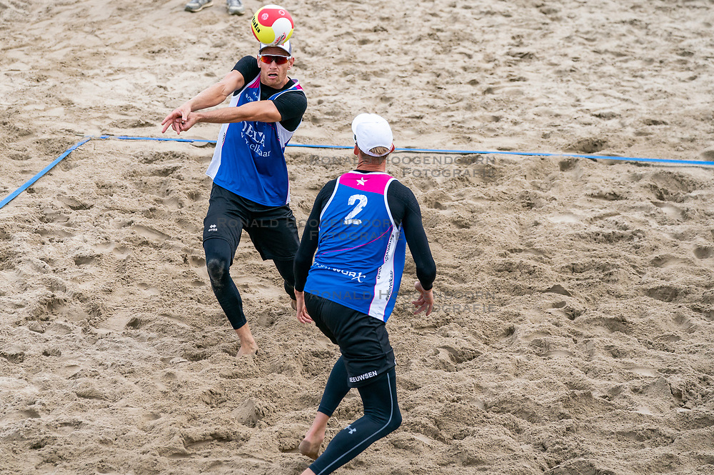 Robert Meeuwsen, Alexander Brouwer in action. The Final Day of the DELA NK Beach volleyball for men and women will be played in The Hague Beach Stadium on the beach of Scheveningen on 23 July 2020 in Zaandam.
