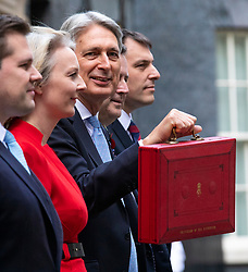 © Licensed to London News Pictures. 29/10/2018. London, UK. The Chancellor of The Exchequer Philip Hammond with the red dispatch box (centre) as he leaves 11 Downing Street before delivering the budget in Parliament. Photo credit: Rob Pinney/LNP