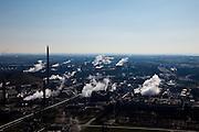 Nederland, Limburg, Gemeente Sittard-Geleen., 07-03-2010; Chemelot,  complex voor chemische industrie in westelijke mijnstreek, huisvest onder andere DSM (De Staatsmijnen, Dutch State Mines). Voormalige terrein van de Staatsmijn Maurits. Stoom en rook ontsnapt aan koeltorens en schoorstenen..Chemelot complex for chemical industry in former western mining district, home to DSM (Dutch State Mines). Former site of mine Maurice. Steam and smoke escapes from cooling towers and chimneys..luchtfoto (toeslag), aerial photo (additional fee required).foto/photo Siebe Swart