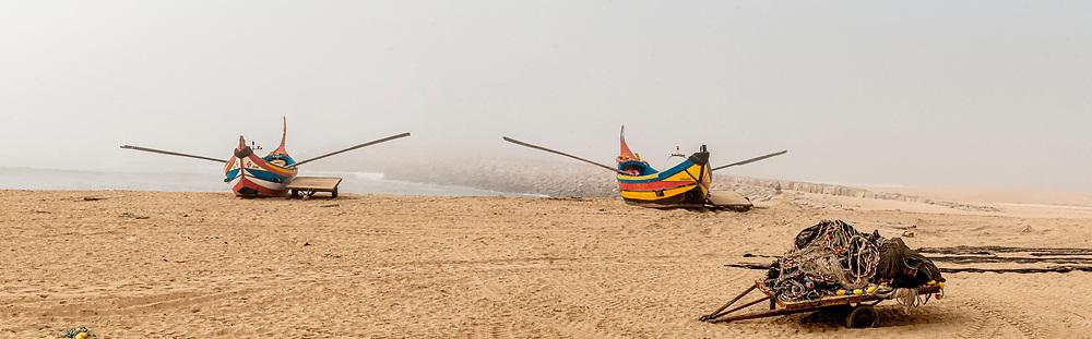 Traditional Portuguese fishing boats on the Atlantic Ocean coast near Vila Nova de Gaia, Portugal