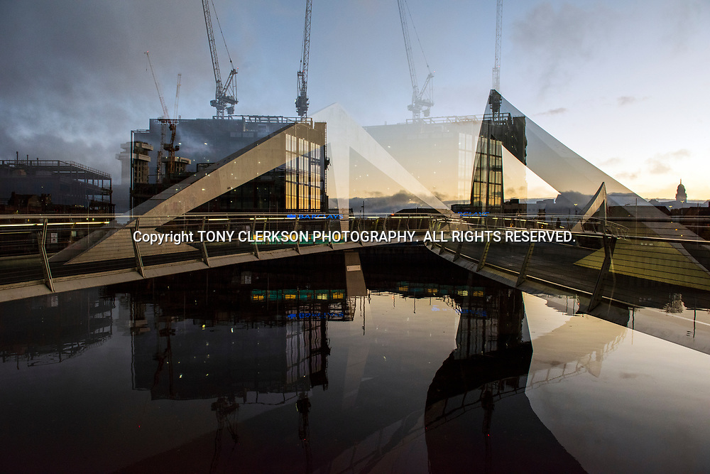 Double exposure image of the Squiggly Bridge and the Buchanan Wharf development as Glasgow's financial district expands south of the river