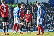 Barnsley Midfielder, Cameron McGeehan (8) shown a yellow card during the EFL Sky Bet League 1 match between Portsmouth and Barnsley at Fratton Park, Portsmouth, England on 23 February 2019.