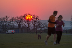 © Licensed to London News Pictures; 26/03/2020; Bristol, UK. Coronavirus Pandemic 2020; people walk on Bristol Downs at sunset during the UK wide lockdown declared by the prime minister on Monday evening, with the biggest restrictions on freedom of movement ever imposed in the UK. People are told to stay at home except for essential work that cannot be done at home, shopping for food, medical appointments and taking exercise once a day all while maintaining social distance. Photo credit: Simon Chapman/LNP.