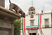 Fuente de los Perritos or Puppy Fountain outside the government palace or Palacio de Gobierno along the Plaza de Armas in the old colonial section of Santiago de Queretaro, Queretaro State, Mexico.