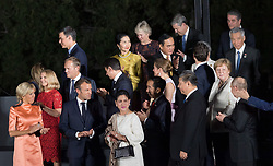 Brigitte Macron, French President Emmanuel Macron, wife of Joko Widodo and Indonesia's President Joko Widodo, China President Xi Jinping and German Chancellor Angela Merkel during family photo session on the first day of the G20 summit in Osaka, Japan on June 28, 2019. Photo by Jacques Witt/Pool/ABACAPRESS.COM