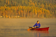 Canoeing on a calm morning on Whitfish Lake in Montana model released