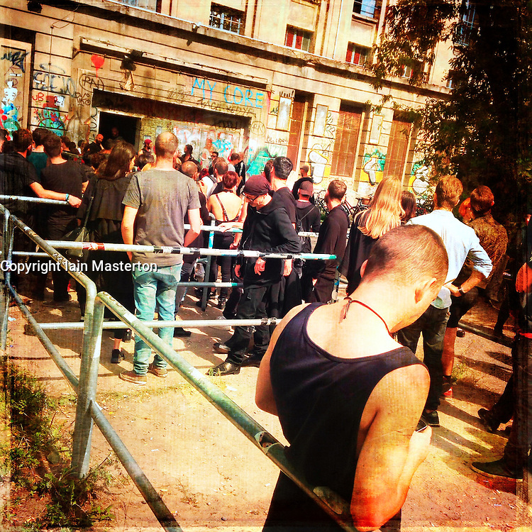 Clubbers queuing to enter  Berghain nightclub on a Sunday afternoon in Berlin Germany -- Editorial Use Only