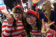 Two Japanese women, dressed as the character Waldo during the Halloween celebrations in Shibuya, Tokyo, Japan. Saturday October 29th 2016 Halloween celebration in Japan have grown massively in the last few years. To ensure the safety of the crowds in Shibuya this year, the police closed several roads leading to the famous Hachiko Square, allowing costumed revellers to spread over a larger area.