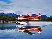 Lake Clark Air Service's de Havilland DHC3 Otter landing in the channel of Hardenburg Bay, Port Alsworth, Lake Clark, Alaska.