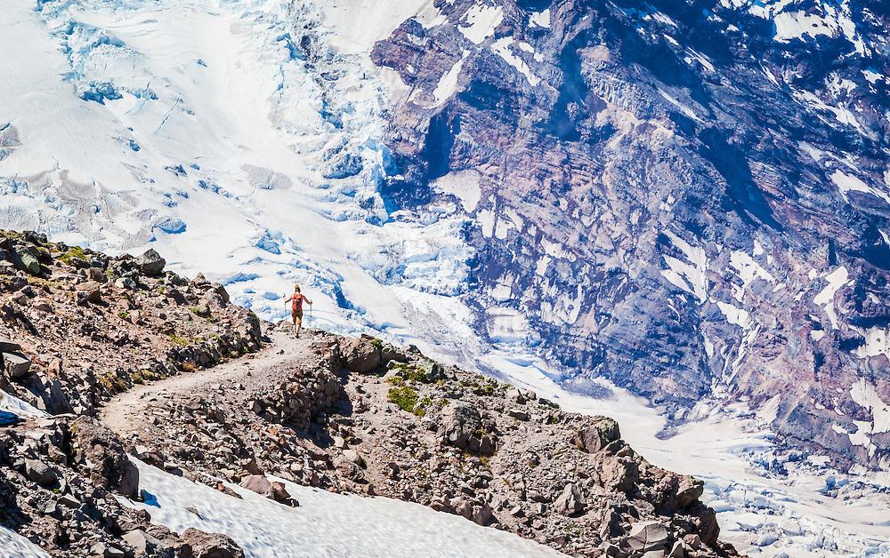 A woman hiking on First Burroughs Mountain below Mount Rainier, Washington, USA