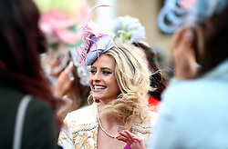 A female racegoer takes part in the Miss Cheltenham finalists line up during Ladies Day of the 2018 Cheltenham Festival at Cheltenham Racecourse.