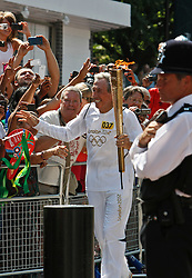 © Licensed to London News Pictures. 25/07/2012. London, U.K..Gordon Banks, ex England goalkeeper, takes the torch down Wembley Way. The Olympic torch relay reaches Wembley Stadium today 25/7/2012, two days before the London Olympic 2012 games begin..Photo credit : Rich Bowen/LNP