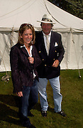 The Marquess and Marchioness of Blandford, Cartier Style Et Luxe, Goodwood, 27 June 2004. SUPPLIED FOR ONE-TIME USE ONLY-DO NOT ARCHIVE. © Copyright Photograph by Dafydd Jones 66 Stockwell Park Rd. London SW9 0DA Tel 020 7733 0108 www.dafjones.com