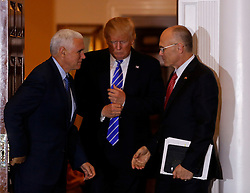 Andrew Puzder (R), chief executive of CKE Restaurants, leaves the clubhouse of Trump International Golf Club, after meeting with President-elect Donald Trump (C) and Vice President-elect Mike Pence (L), November 19, 2016 in Bedminster Township, New Jersey. (Aude Guerrucci / Pool)