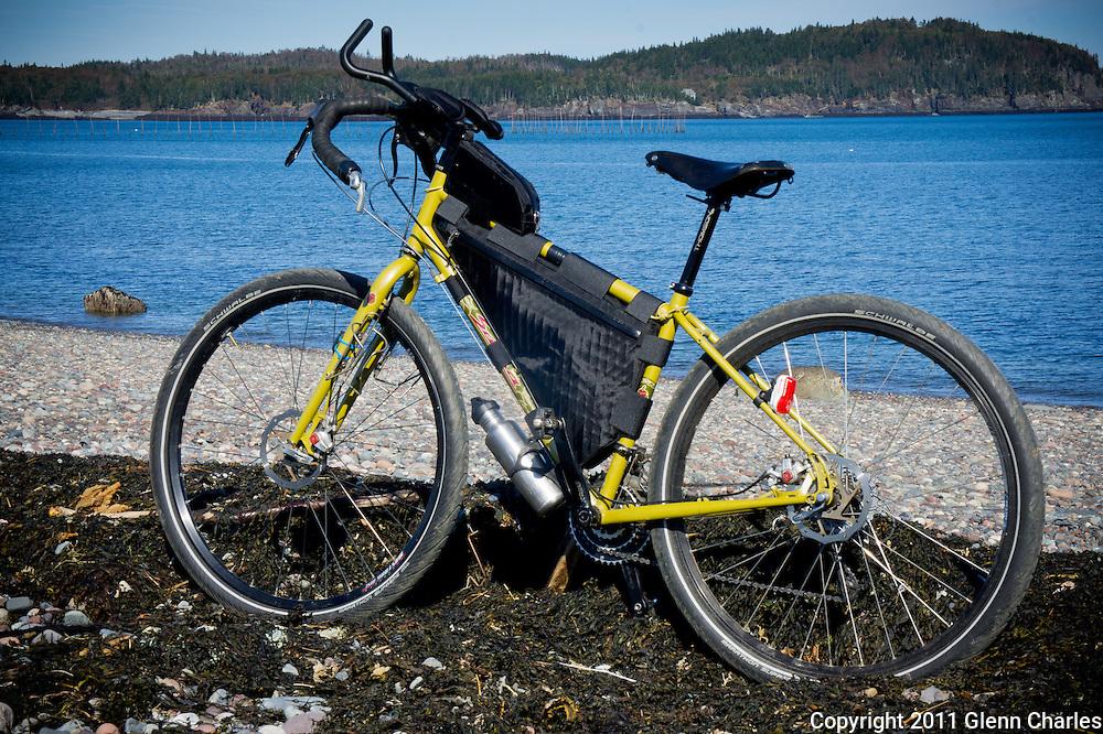 Salsa Fargo with Porcelain Rocket frame bag and top tube bag.  Adventure cycling the International park on Campobello Island