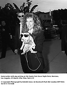 Gatecrasher with pig arriving at the Vanity Fair Oscar Night Party Mortons,  Los Angeles. 25 March 1996. Film. 96211/19<br /><br />© Copyright Photograph by Dafydd Jones<br />66 Stockwell Park Rd. London SW9 0DA<br />Tel 0171 733 0108