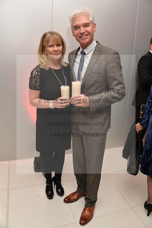 PHILLIP SCHOFIELD and his wife STEPHANIE at a pre party for the English National Ballet's Christmas performance of The Nutcracker was held at the St.Martin's Lane Hotel, St.Martin's Lane, London on 12th December 2013.