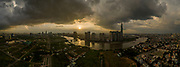 Saigon River aerial panorama with Ho Chi Minh City Skyline during a stormy sunset. Color is a natural warm tone due to weather. Ho Chi Minh City is the finance and business capital of Vietnam.