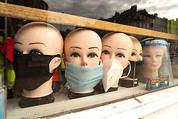 Edinburgh, Scotland, UK. 12 July, 2020, Business slowly returning to normal in Edinburgh city centre. Face masks displayed in shop window in the city Iain Masterton/Alamy Live News