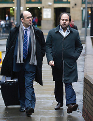 © Licensed to London News Pictures. 19/01/2012. London, UK. Indian businessman Kautilya Nandan Pruthi (right) arriving at Southwark Crown Court today (19/01/2012) where he is accused of masterminding a £115 million 'Ponzi' scam that claimed several high-profile victims. Pruthi allegedly ran a bogus high yield fund which offered clients returns of up to 13% a month. Photo credit : Ben Cawthra/LNP