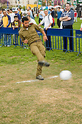 Israeli soldier kicking a football