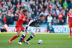 Millwall's Martyn Woolford shields the ball from Charlton Athletic's Diego Poyet - Photo mandatory by-line: Robin White/JMP - Tel: Mobile: 07966 386802 15/03/2014 - SPORT - FOOTBALL - The Den - Millwall - Millwall v Charlton Athletic - Sky Bet Championship