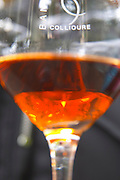Glass with red wine rancio. Glass embossed with Collioure. Roussillon. France. Europe.