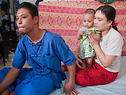 Oct. 6, 2009 -- SAMUT SAKHON, THAILAND: TUN, 37 years old, and his wife, KHAI, and their baby daughter, KHANWAND, in their one room tenement in Samut Sakhon, Thailand. Tun has lived in Thailand in for 15 years and has a Thai work permit. He was smuggled to Samut Sakhon from the Thai/Burma border near Kanchanaburi, Thailand. His wife came to Thailand from near Myawaddy, Burma three years ago to work in a fish processing plant in Samut Sakhon. The Thai fishing industry is heavily reliant on Burmese and Cambodian migrants. Burmese migrants crew many of the fishing boats that sail out of Samut Sakhon and staff many of the fish processing plants in Samut Sakhon, about 45 miles south of Bangkok. Migrants pay as much $700 (US) each to be smuggled from the Burmese border to Samut Sakhon for jobs that pay less than $5.00 (US) per day.   Photo by Jack Kurtz / ZUMA Press