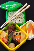 """School Bento - The origin of bento can be traced back to the Kamakura Period when cooked and dried rice called hoshi-ii literally """"dried meal"""" was developed. In the Edo Period bento culture spread and became more refined. Travelers would carry a simple bentoconsisting of several onigiri wrapped with bamboo leaves or in a woven bamboo box.   Bento became even more populari in the 1980s with the help of the microwave and the proliferation of convenience stores. The expensive wood and metal boxes have been replaced at most bento shops with inexpensive, disposable plastic boxes. However, even handmade bento have made a comeback, and they are once again a common sight at Japanese schools where they are known as gakko bento or school bento lunches."""
