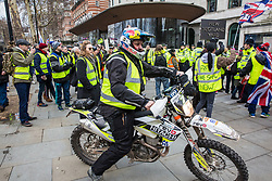 London, UK. 2nd February, 2019. Supporters of Yellow Vests UK protest outside New Scotland Yard to call for 'British people to be put first', for a 'full Brexit' and for 'an end to government, court and banking corruption'.
