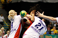 20111216: SAO PAULO, BRAZIL -<br />  XX World Handball Angola x Rússia in Ibirapuera Gym at Sao Paulo, Brazil.<br /> In photo: Sen (Russia), Zhilinskayte(Russia) and Nair (Angola).<br /> PHOTO: CITYFILES
