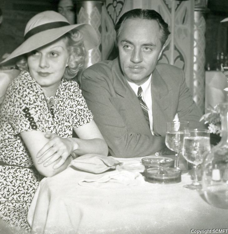 1936 Jean Harlow and William Powell dine at the Cocoanut Grove.