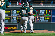 Dan Otero #61 and Derek Norris #36 of the Oakland Athletics celebrate after the Athletics defeated the Minnesota Twins on April 9, 2014 at Target Field in Minneapolis, Minnesota.  The Athletics defeated the Twins 7 to 4.  Photo by Ben Krause
