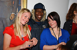 Left to right, IRIS ANDREWS, DIZZEE RASCAL and ALICIA KEARNS at the opening of an exhibition entitled Exceptional Youth supported by Teen Vogue at the National Portrait Gallery, London on 3rd November 2006.<br /><br />NON EXCLUSIVE - WORLD RIGHTS