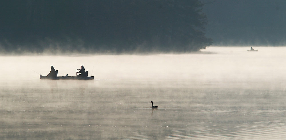 (PPAGE1) Jackson $/10/2004  Fisherman in a fog rising off the water of Prospertown Lake in Jackson during the opening day of trout season.  Michael J. Treola Staff Photographer.....MJT