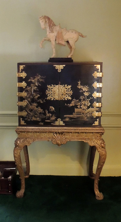 Japanese black and gold laquered Cabinet on stand. Dated 1714