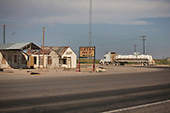 Truck passing by blighted buildings in the Permian Basin in West Texas. Despite the fracking boom there is a lot of blight a long Texas highways in the Permian Basin.