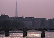 Pont des Artes with the Eiffel Tower in the background on a hazy purple day