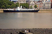Looking across the River Thames to HMS President on the Embankment, London