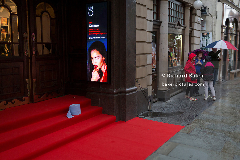 A rain-soaked red carpet that awaits crowds seeing the English National Opera's opening night of Orpheus and Eurydice at the Coliseum on St. Martin's Lane, on 1st October 2019, in London, England.