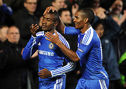 LONDON, ENGLAND - Wednesday, October 19, 2011: Chelsea's Salomon Kalou is congratulated by team-mate Florent Malouda after scoring his side's fifth goal during the UEFA Champions League Group E match at Stamford Bridge. (Photo by Chris Brunskill/Propaganda)