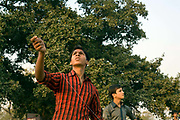 Kite flying festival, New Delhi, IndiaBoys flying a kite during a kite flying festival at India Gate, New Delhi India