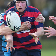 Arrowtown's Ed Spence is tackled during the Wakatipu V Arrowtown Rugby Match at Queenstown Recreation Ground,  Queenstown, South Island, New Zealand, 11th June 2011