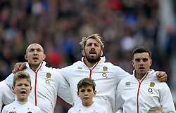 England's Mike Brown (L - R) Chris Robshaw and George Ford sing the national anthem before the Autumn International at Twickenham Stadium, London.