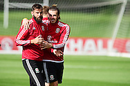 Gareth Bale of Wales ® jokes with Joe Ledley during the Wales football team training session at the Vale Resort, Hensol Castle near Cardiff ,South Wales on Monday 31st August  2015. The team are preparing for their next EURO 2016 qualifying match away to Cyprus later this week.<br /> pic by Andrew Orchard, Andrew Orchard sports photography.