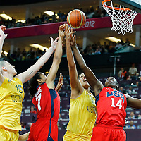 09 August 2012: Australia Elizabeth Cambage vies for the rebound with USA Tina Charles, Maya Moore, and Australia Lauren Jackson during 86-73 Team USA victory over Team Australia, during the women's basketball semi-finals, at the 02 Arena, in London, Great Britain.