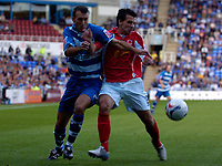 Photo: Alan Crowhurst.<br />Reading v Crewe Alexandra. Coca Cola Championship.<br />17/09/2005. Glen Little (L) of Reading takes on Anthony Tonkin of Crewe.